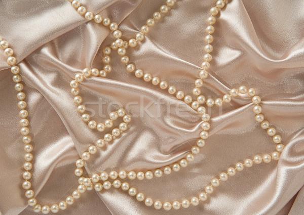 Gyöngyök szatén háttér selyem luxus dekoráció Stock fotó © danny_smythe