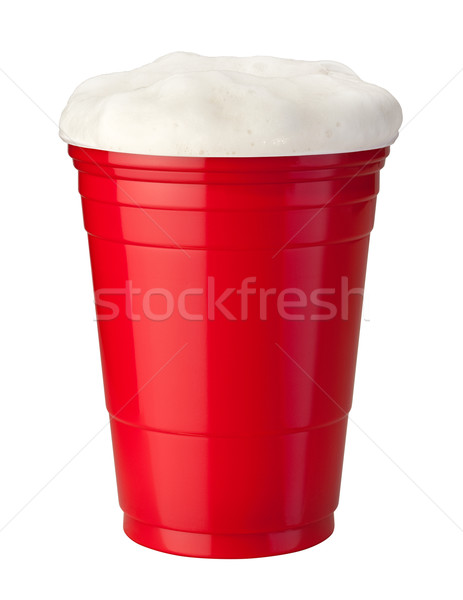Cerveja plástico copo vermelho isolado branco Foto stock © danny_smythe