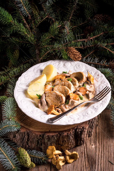 potatoes with pork medallions and chanterelle sauce Stock photo © Dar1930