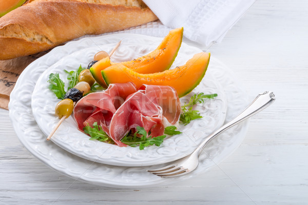 Ham with melon and olives Stock photo © Dar1930