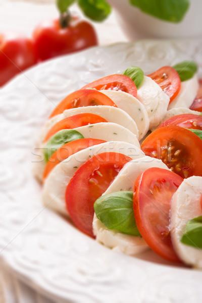 tomato with mozzarella cheese - selective sharpness-deep Stock photo © Dar1930