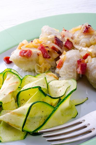 Stock photo: Silesian dumplings with Bacon and zucchini