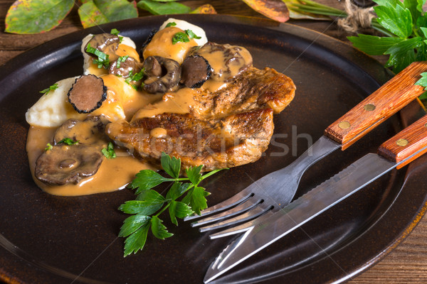 Steak with potato dumplings and forest mushroom sauce Stock photo © Dar1930