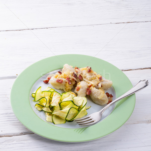 Stock photo: Silesian dumplings with Bacon and zucchini