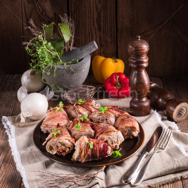 Töltött disznóhús étel gyümölcs zöld vacsora Stock fotó © Dar1930