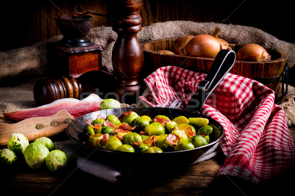 Honey caramelized brussels sprouts with ham Stock photo © Dar1930