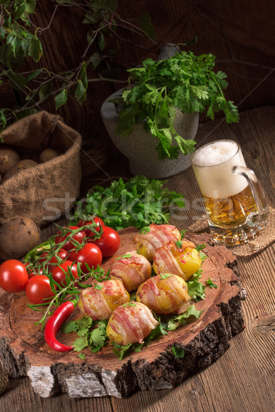 Stock photo: Baked potatoes wrapped in ham