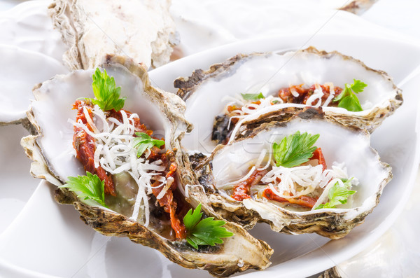 oysters with parmesan and baked tomatoes Stock photo © Dar1930