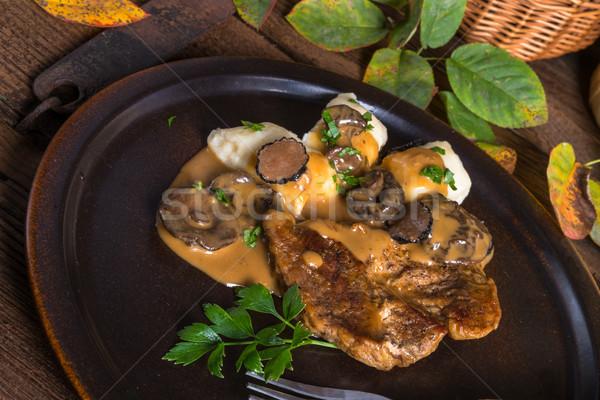 Stock photo: Steak with potato dumplings and forest mushroom sauce