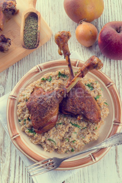 roasted goose thighs with grits - retro vintage Stock photo © Dar1930