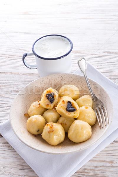 Stock photo: Potato dumplings with plums full