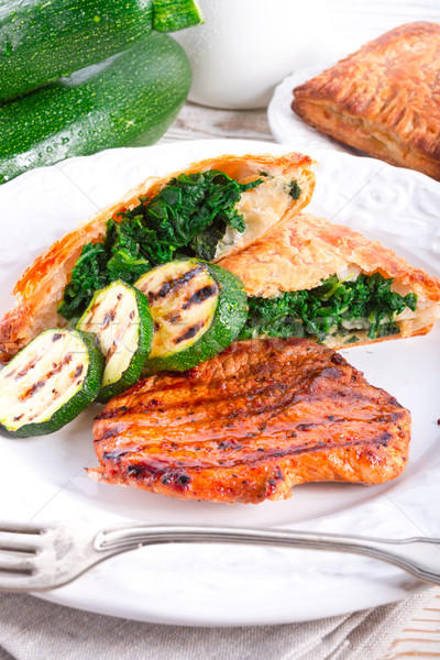 Stock photo: grilled steaks with puff pastry bag and zucchini
