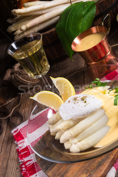 white asparagus served with a fine hollandaise sauce and Poache Stock photo © Dar1930
