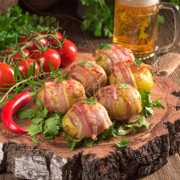 Baked potatoes wrapped in ham Stock photo © Dar1930