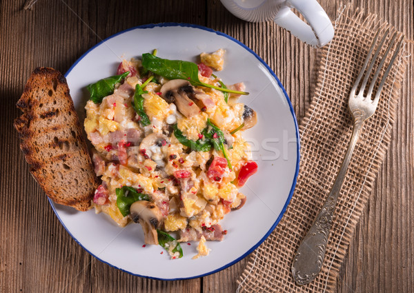 Scrambled eggs with tomatoes and spinach Stock photo © Dar1930