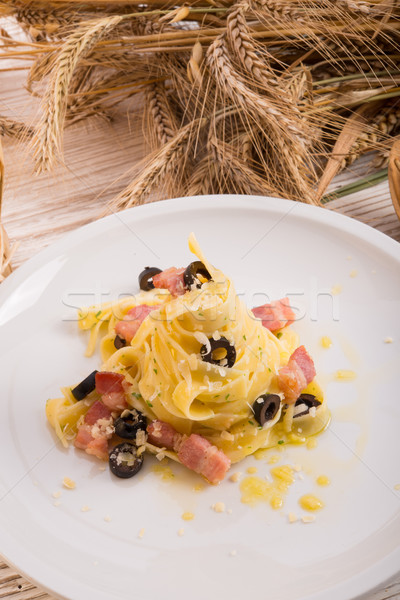 tagliatelle with bacon and blacken to olive ones Stock photo © Dar1930