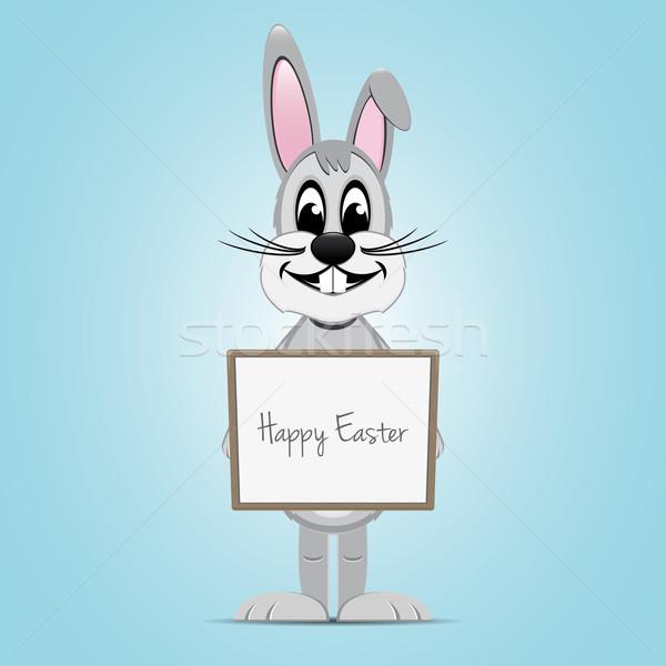 easter bunny hold signboard Stock photo © dariusl