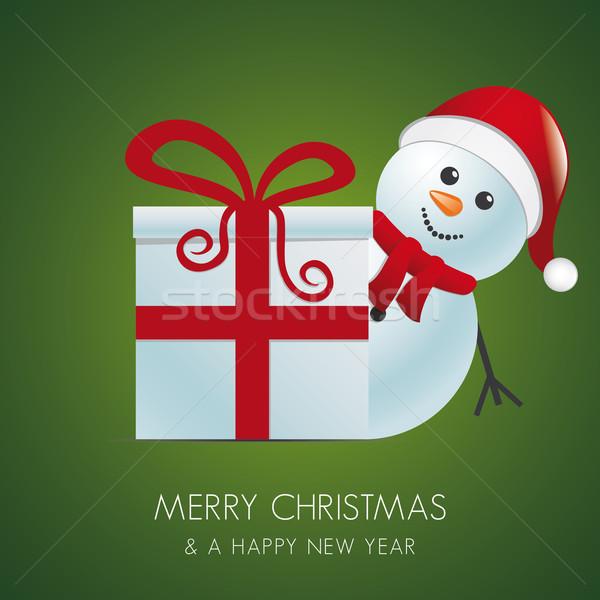 snowman santa hat behind gift box Stock photo © dariusl