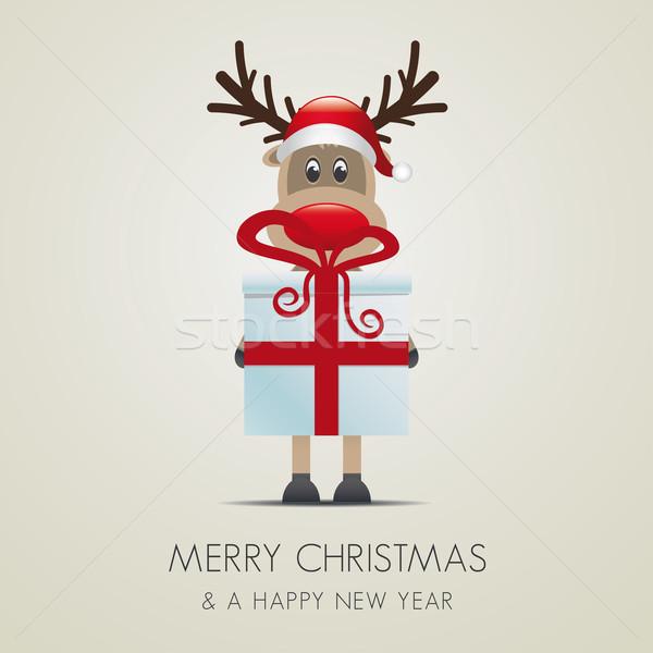 reindeer hold gift boxes Stock photo © dariusl