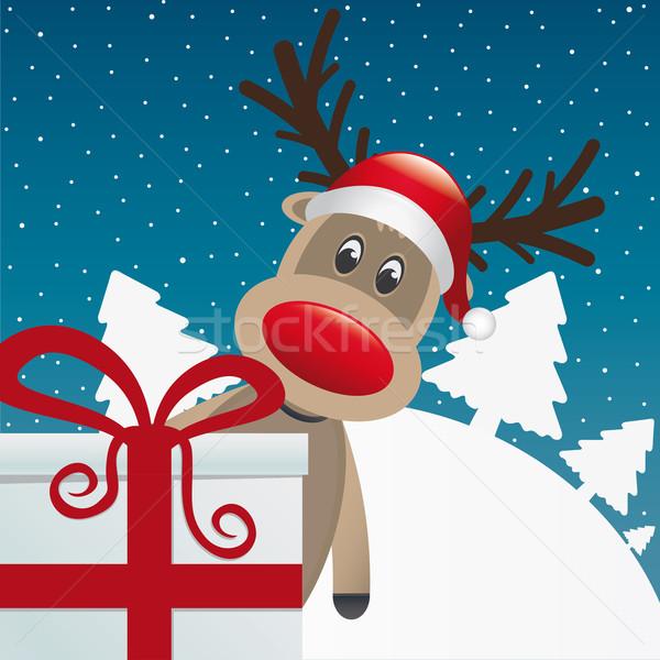 Ren geyiği arkasında hediye kırmızı beyaz şerit Stok fotoğraf © dariusl