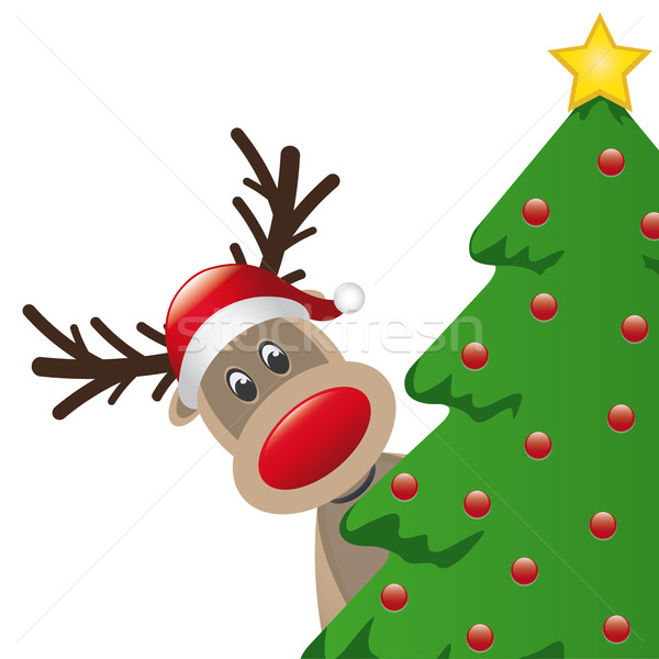 reindeer with santa hat behind tree Stock photo © dariusl
