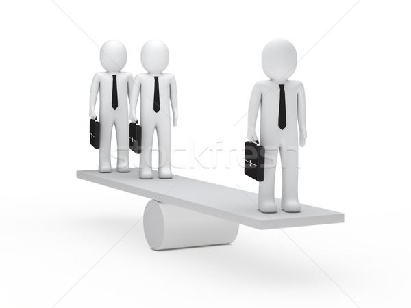 businessmen balance on seesaw Stock photo © dariusl