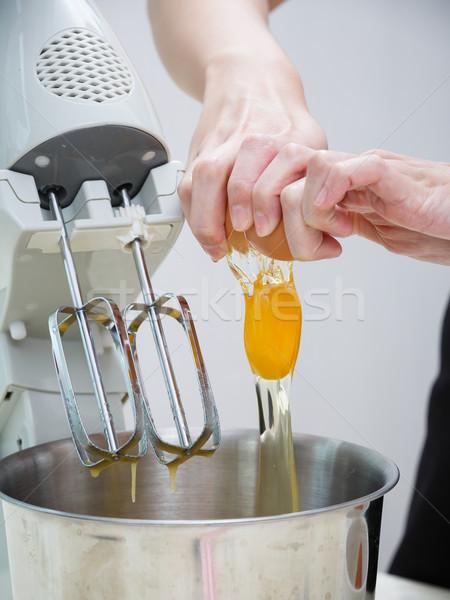 breaking egg Stock photo © darkkong