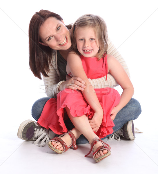 Mother daughter fun and laughter sitting on floor Stock photo © darrinhenry