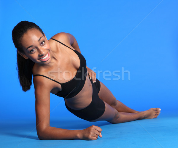 Side plank ab exercise by fit young black woman Stock photo © darrinhenry