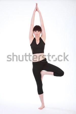 Beautiful fit woman in Yoga Tree Pose Vrksasana Stock photo © darrinhenry