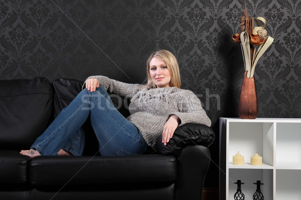 Beautiful blonde woman home on sofa in jumper Stock photo © darrinhenry