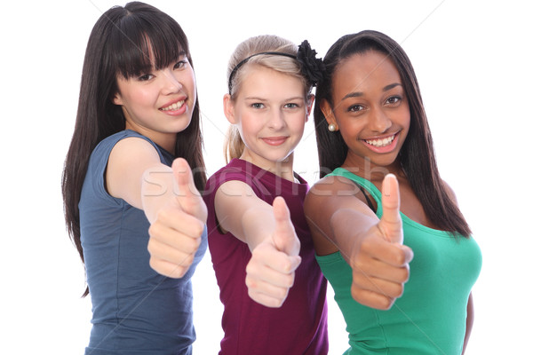 Success for ethnic mix three student girl friends Stock photo © darrinhenry