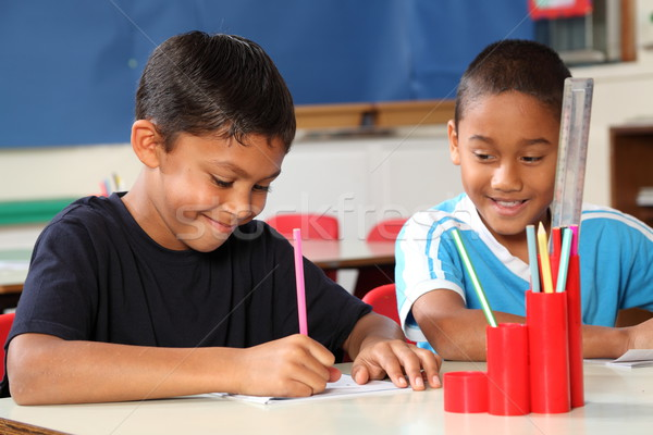 Two happy school boys enjoying their learning in class Stock photo © darrinhenry