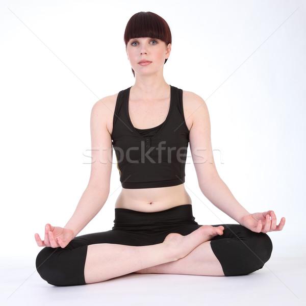Yoga lotus pose padmasana by fit young woman Stock photo © darrinhenry