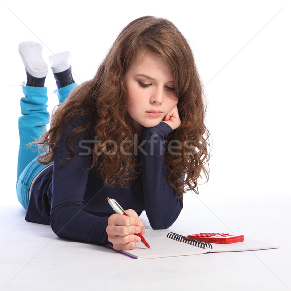 Teenager girl maths homework with calculator Stock photo © darrinhenry