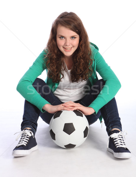 Stock photo: Teenage girl soccer player sits with football