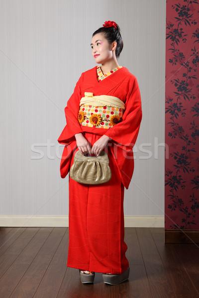 Beautiful oriental woman in red japanese kimono Stock photo © darrinhenry