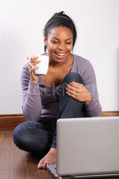 Young student girl at home using laptop online Stock photo © darrinhenry