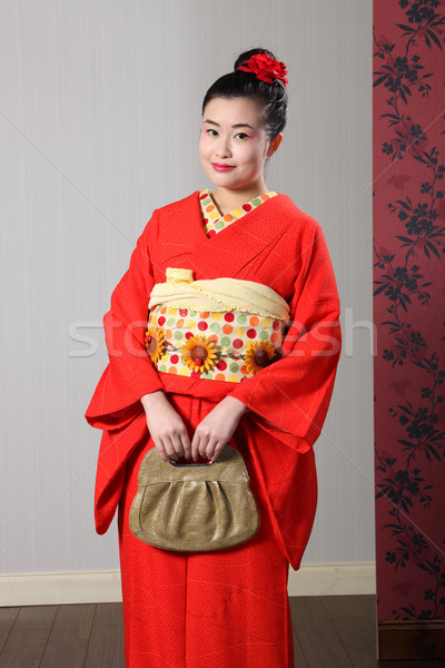 Oriental woman in red traditional japanese kimono Stock photo © darrinhenry