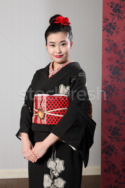 Oriental woman in black japanese kimono robe dress Stock photo © darrinhenry