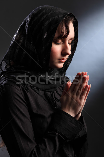 Religious woman meditating in spiritual worship Stock photo © darrinhenry