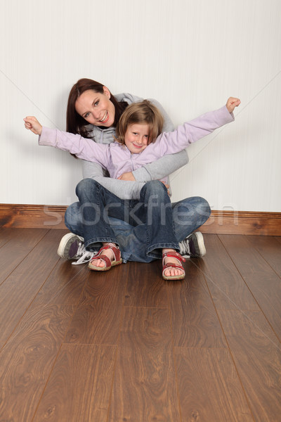 Young mother and daughter sitting on floor at home Stock photo © darrinhenry