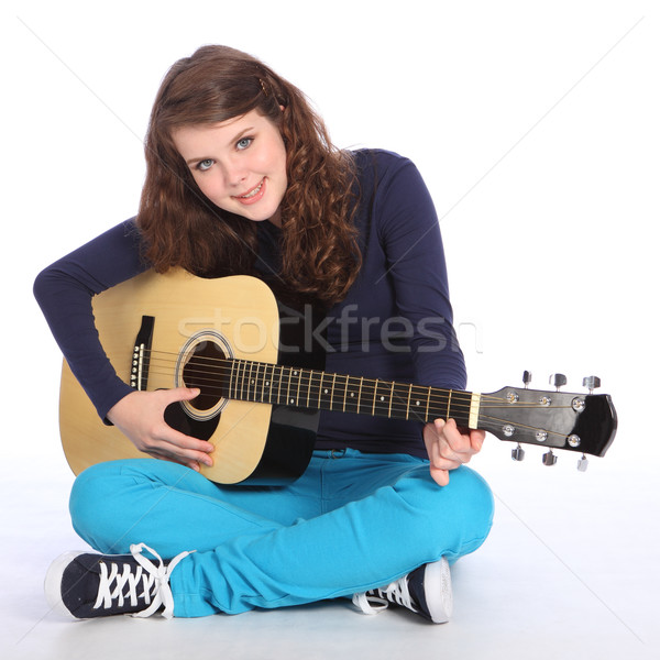 Cute smile by teenager girl on acoustic guitar Stock photo © darrinhenry