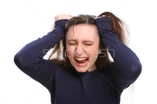 Young woman angry frustrated having bad hair day Stock photo © darrinhenry