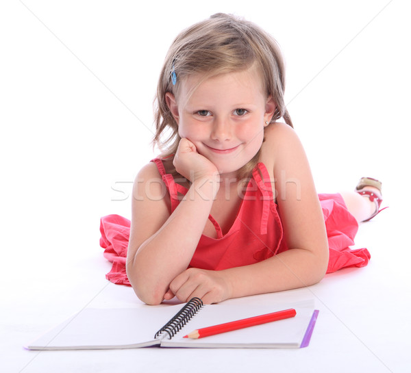 Blonde primary school girl with pencil and paper Stock photo © darrinhenry