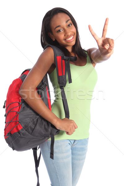 Gyönyörű fekete tinédzser iskolás lány győzelem felirat Stock fotó © darrinhenry
