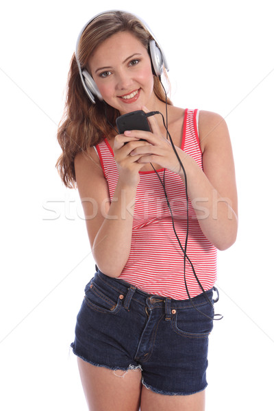Happy beautiful teenage girl music on headphones Stock photo © darrinhenry