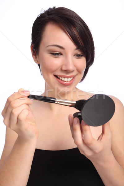 Make up using cosmetic compact and blusher brush Stock photo © darrinhenry