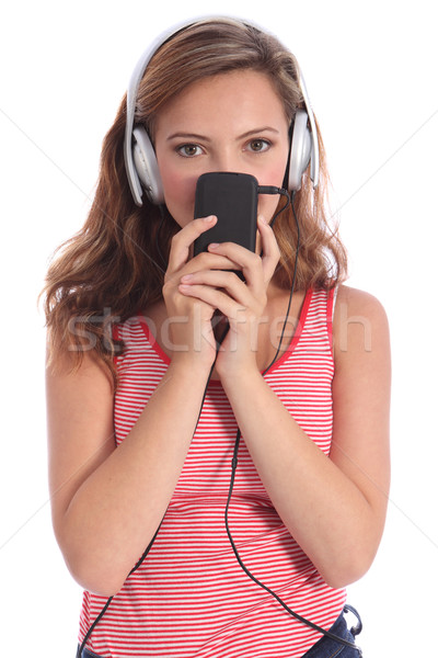 Cute teenager girl listens to music on headphones Stock photo © darrinhenry