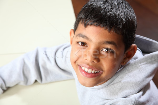 Smiling young ethnic school boy wearing grey hoodie in classroom Stock photo © darrinhenry
